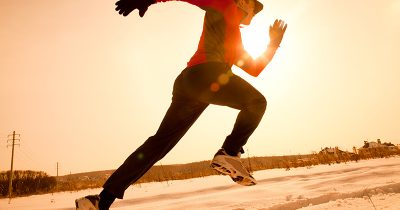 Man jogging in winter snow
