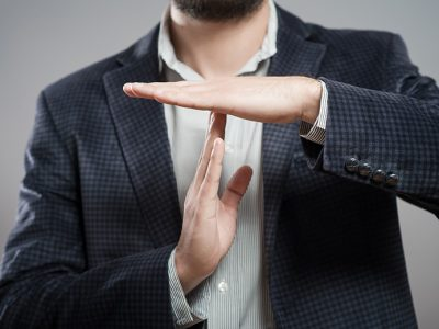 Man presenting the 'Time Out' hand sign