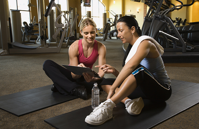 Personal Trainer Discussing Progress with Client
