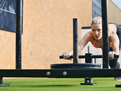 Woman pushing sled/prowler