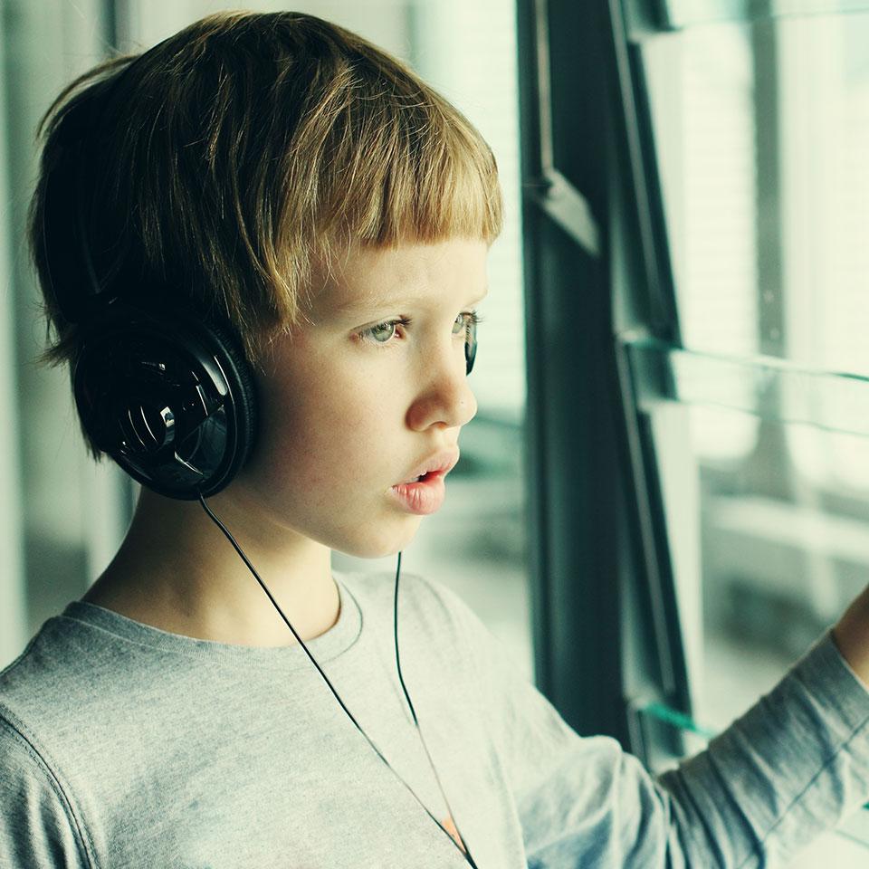 Autistic Child Wearing Headphones