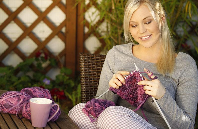Happy woman knitting