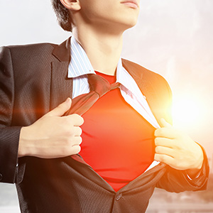 Young Business Man Pulling Shirt Open to Reveal a Red T-Shirt on His Chest in Superman Pose