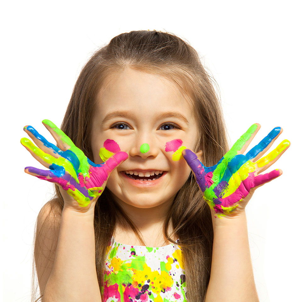 Young girl with hands painted with various colours