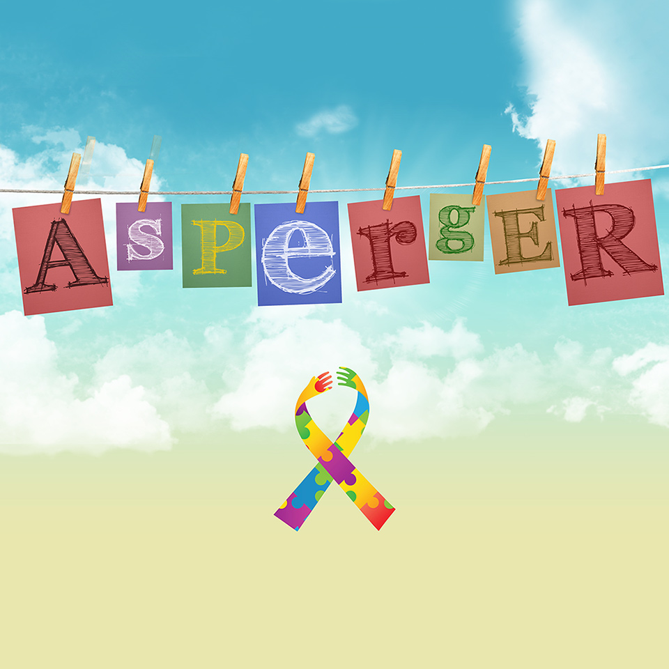 The word 'Asperger' on a washing line above the Autism ribbon symbol