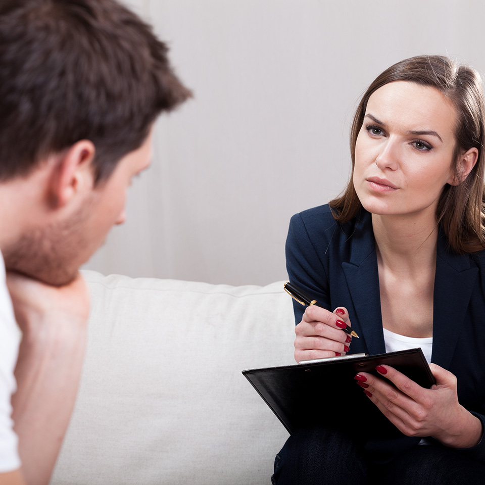 A woman guiding a man through a Gestalt Therapy session