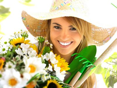 Happy woman with gardening tools