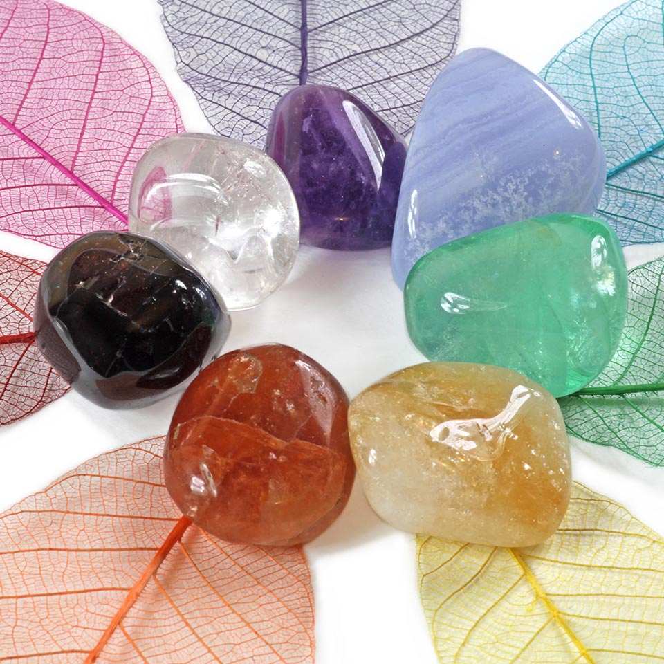 A collection of crystals used in crystal healing - one for each chakra