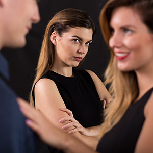 Jealous woman watching her partner talking with another woman