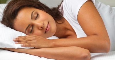 Woman using natural ways to sleep better