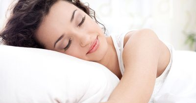 Woman sleeping soundly after completing her beauty routine