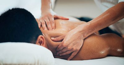 Sportsman receiving aromatherapy sports massage