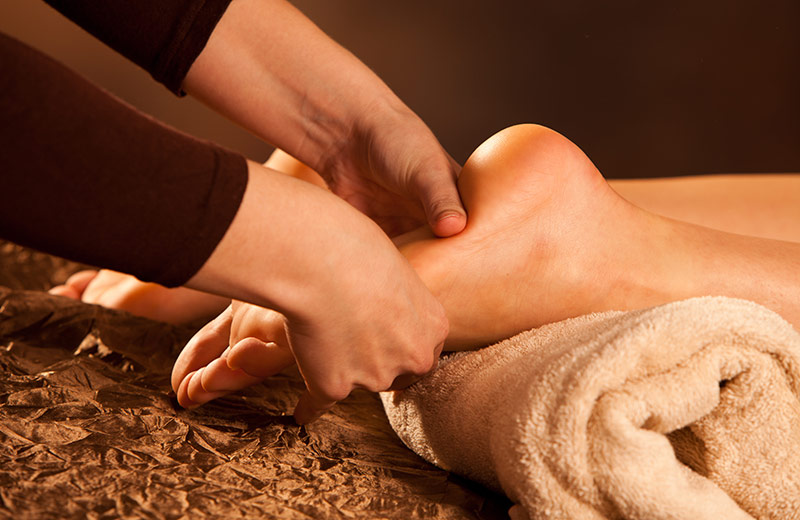 Client receiving reflexology massage