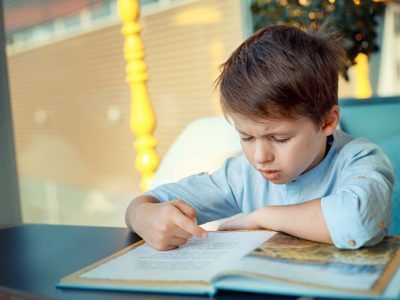 Child with ADHD struggling to focus on school work