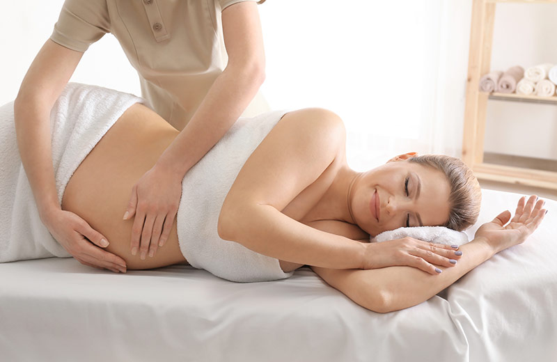 Woman receiving pregnancy massage