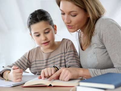 Woman homeschooling her daughter