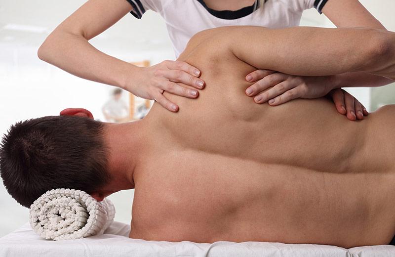 Man receiving sports massage from a massage therapist