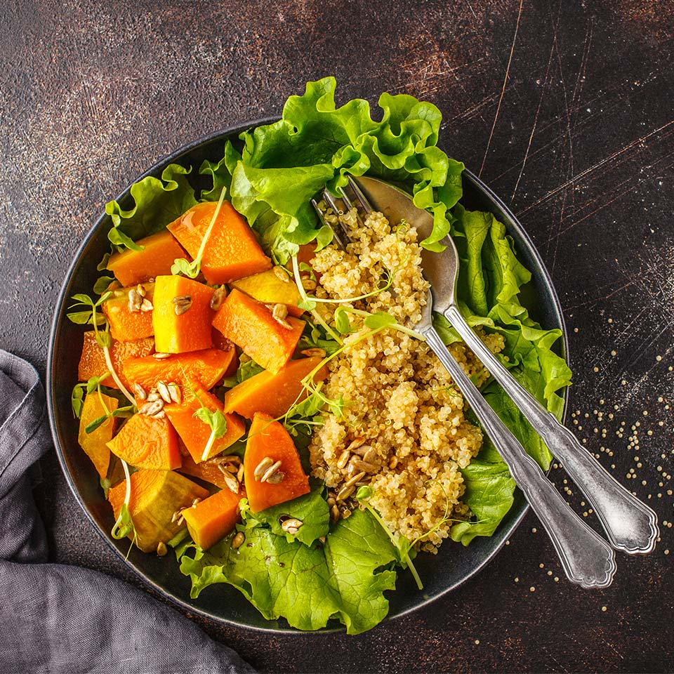 A top down picture of a vegan ketogenic meal Warm quinoa and pumpkin salad