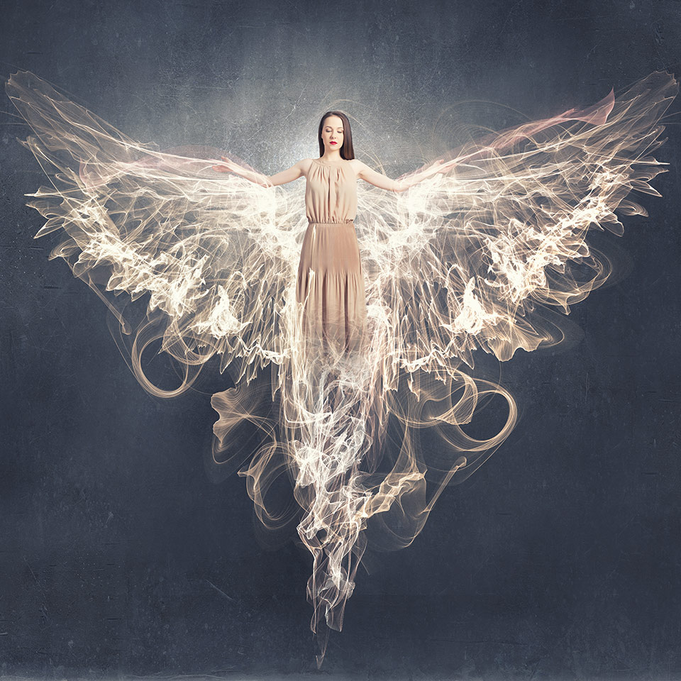 Woman with angel wings on a sky background