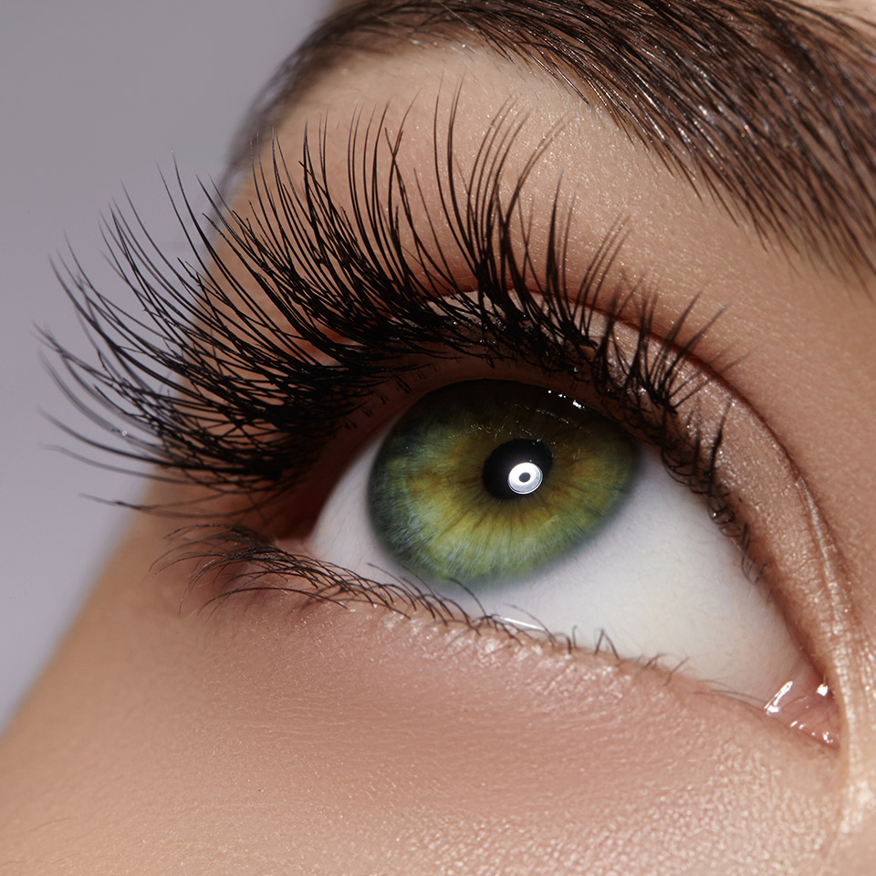 Macro shot of female eye with long eyelashes and black liner makeup