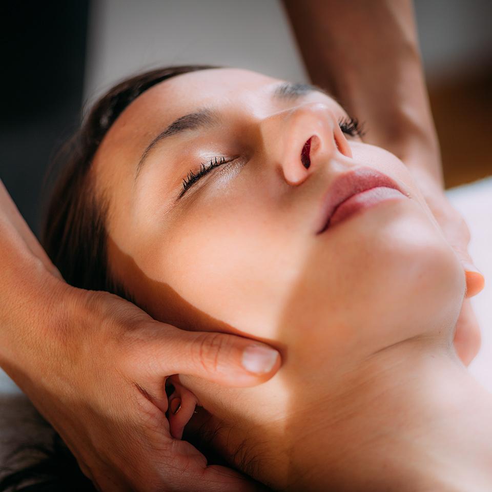 Therapist providing cranial osteopathy massage