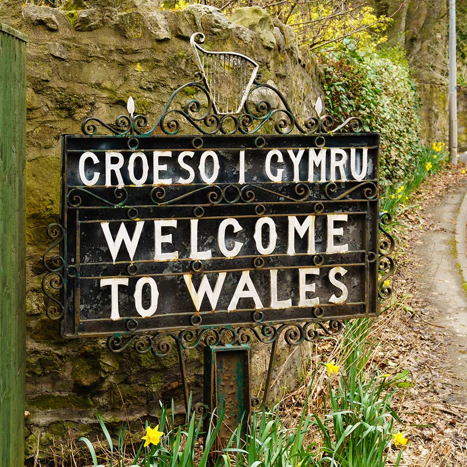 Bilingual Welcome to Wales sign in Welsh and English marking the border between England and Wales