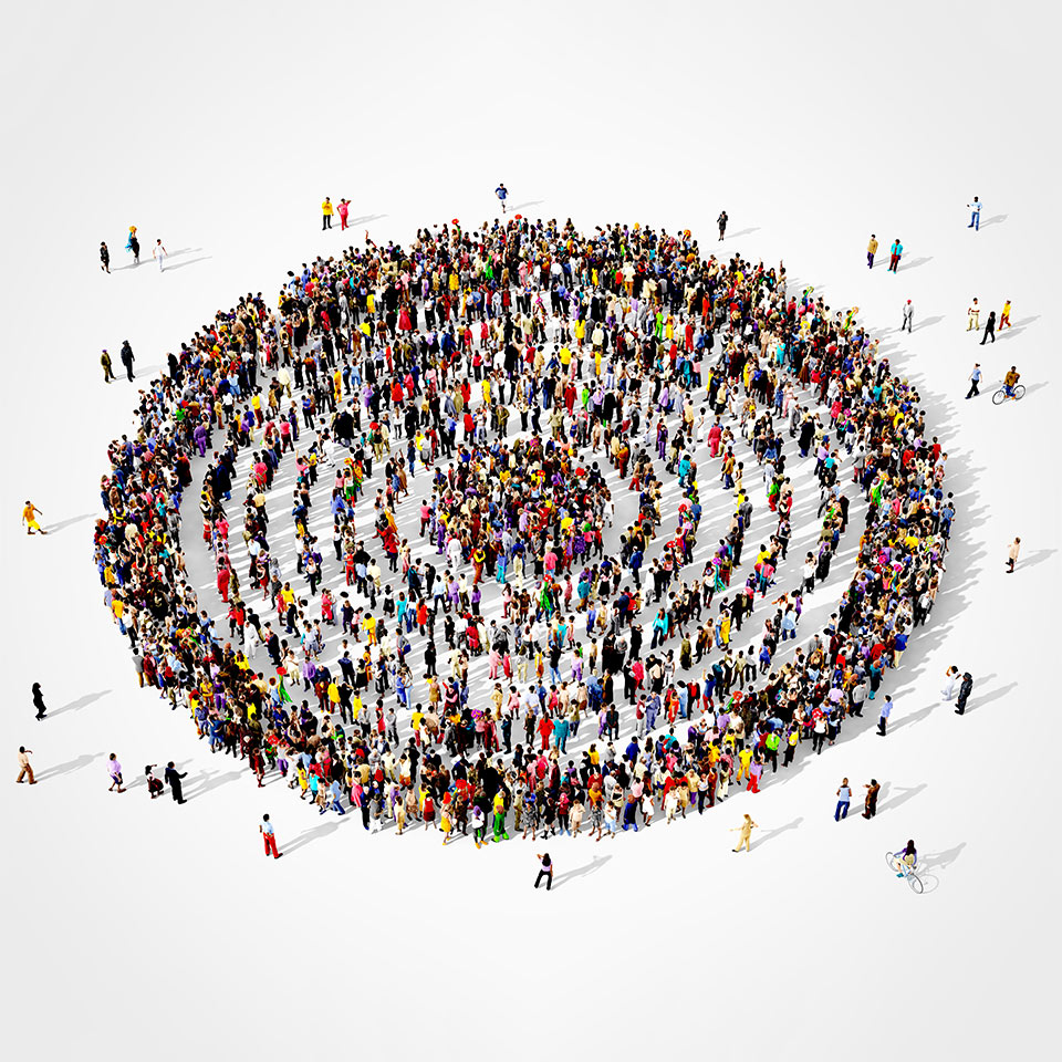 Large and diverse group of people seen from above gathered together in the shape of a concentric circles