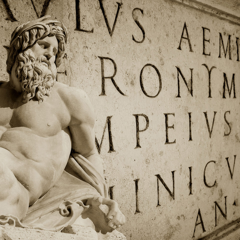 Bernini statue detail of Gange with Latin words engraved on a wall in the Roman Capitol