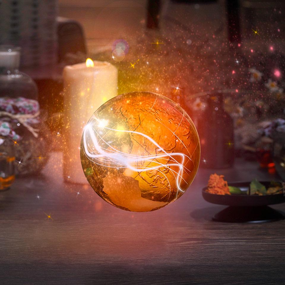 Golden sphere of orange light hovering above an alchemist's table