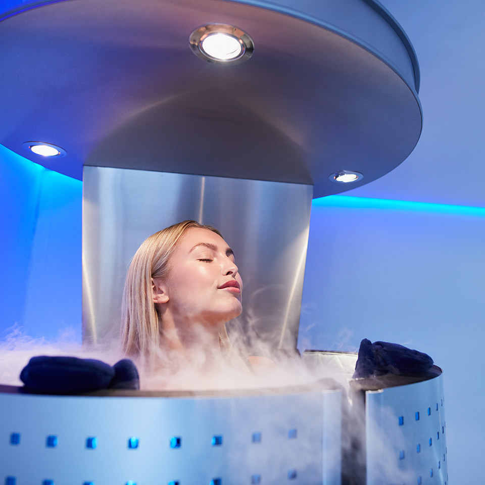 Portrait of a woman in a whole body cryo sauna