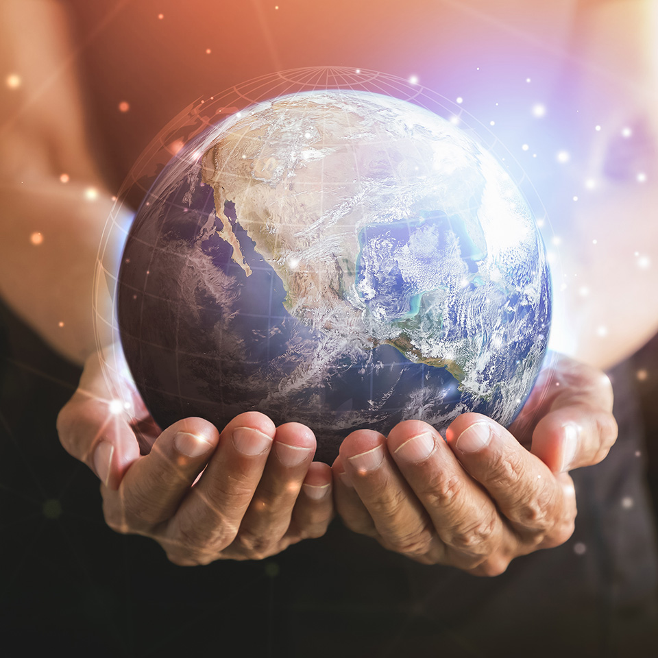 The Earth cradled in a pair of human hands