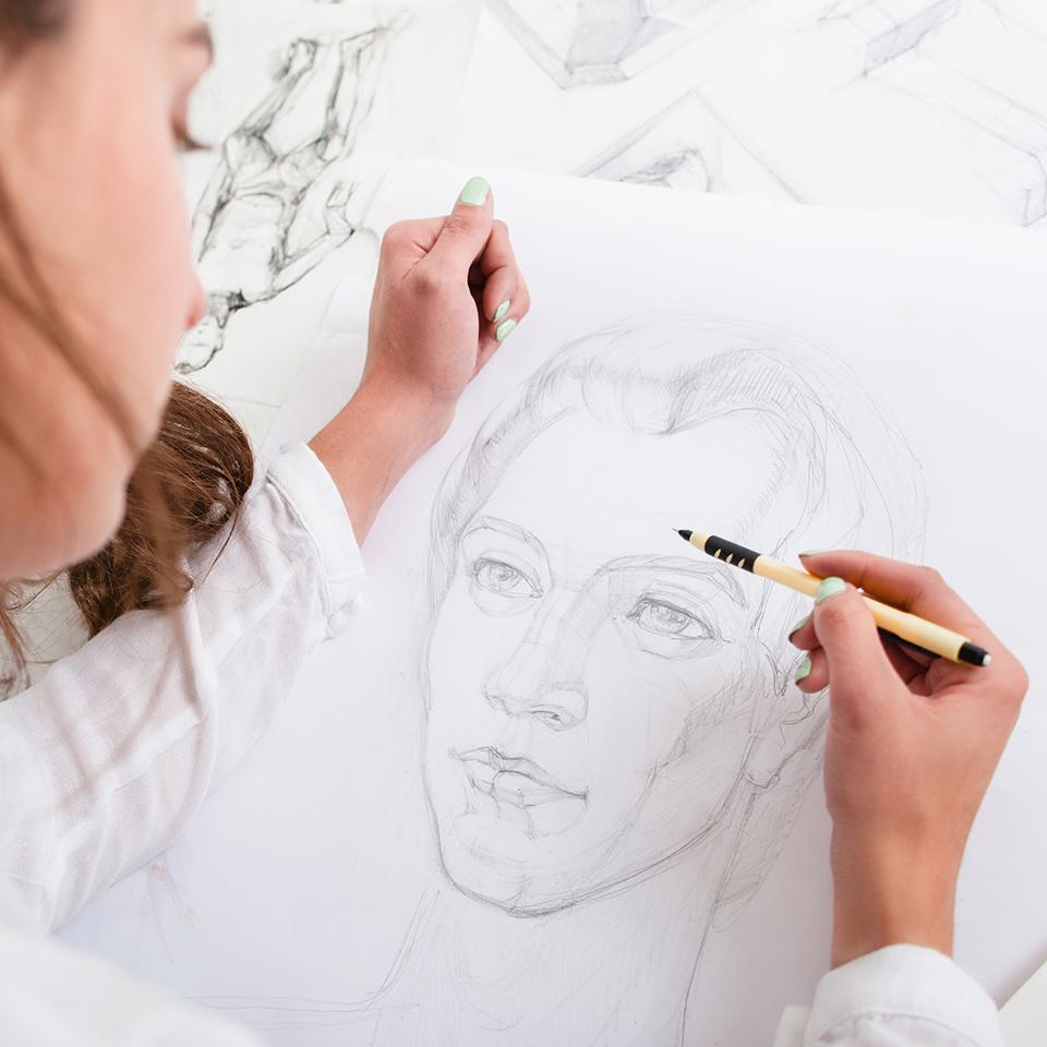 Artist drawing pencil portrait