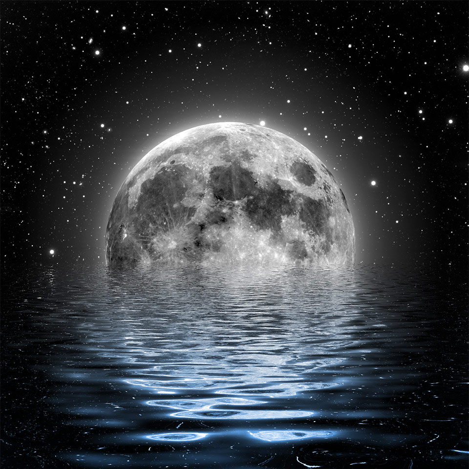A large moon, partially submerged in the sea
