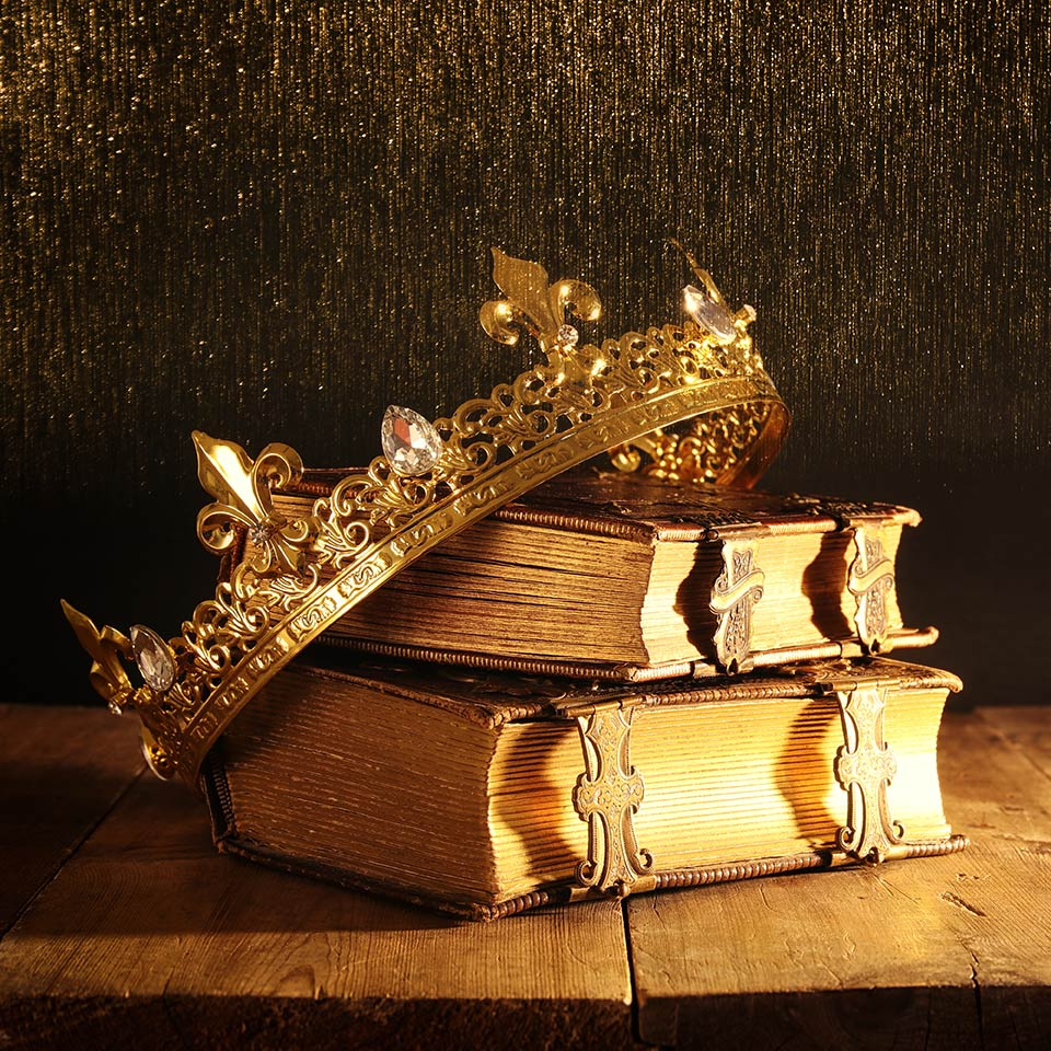 Medieval crown balanced atop some old books