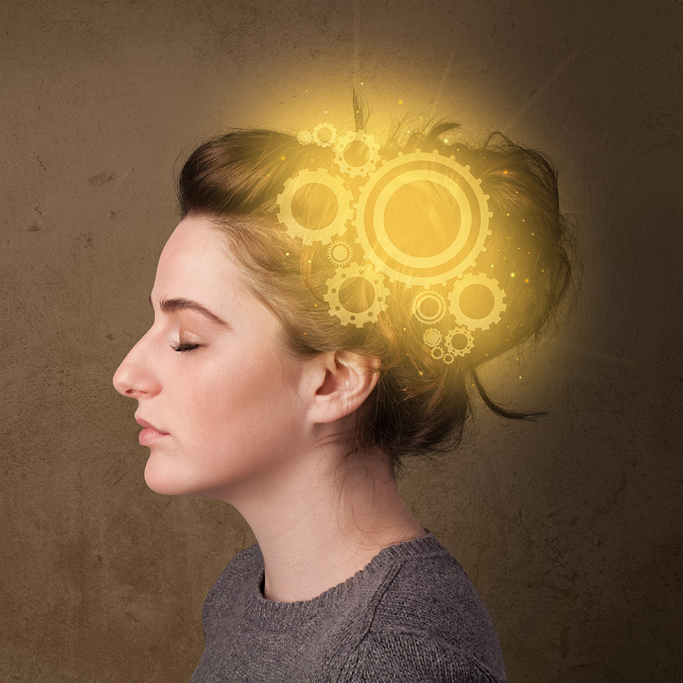 Woman with glowing cogs to illustrate her mind