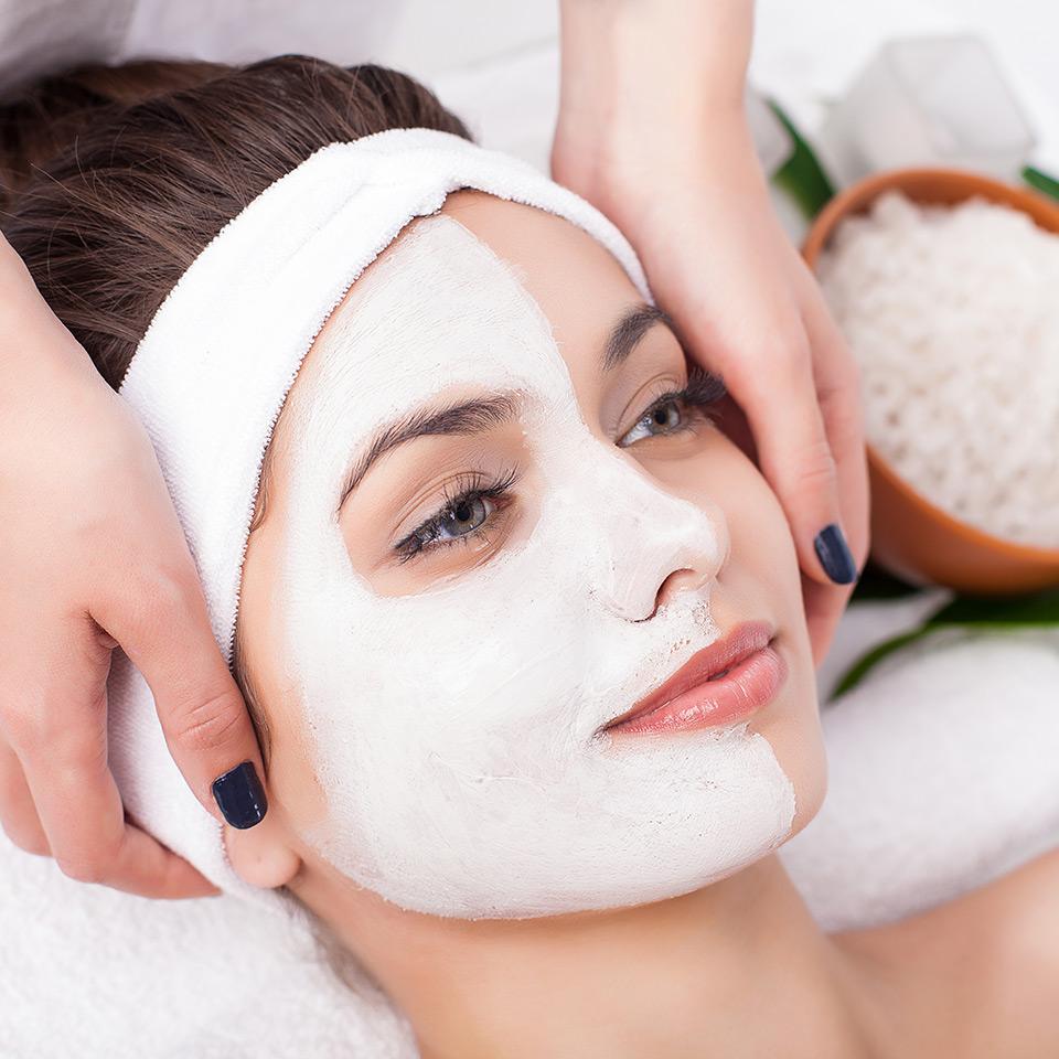 Woman wearing half of a facial mask