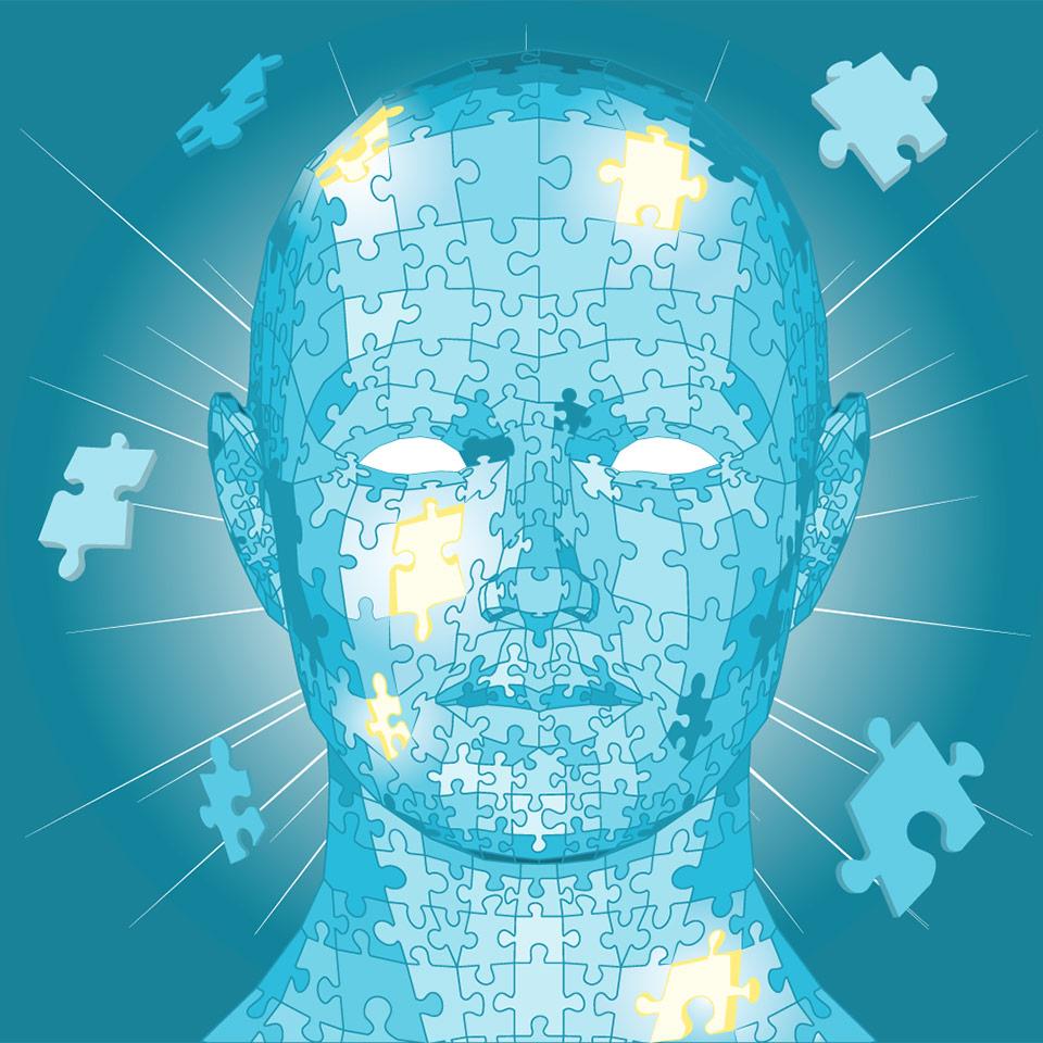 Man's head made of jigsaw pieces