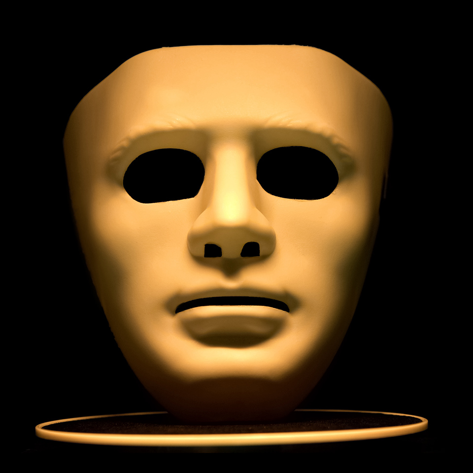 Anonymous mask isolated on a black background