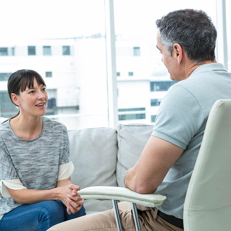 Woman and man in counselling session