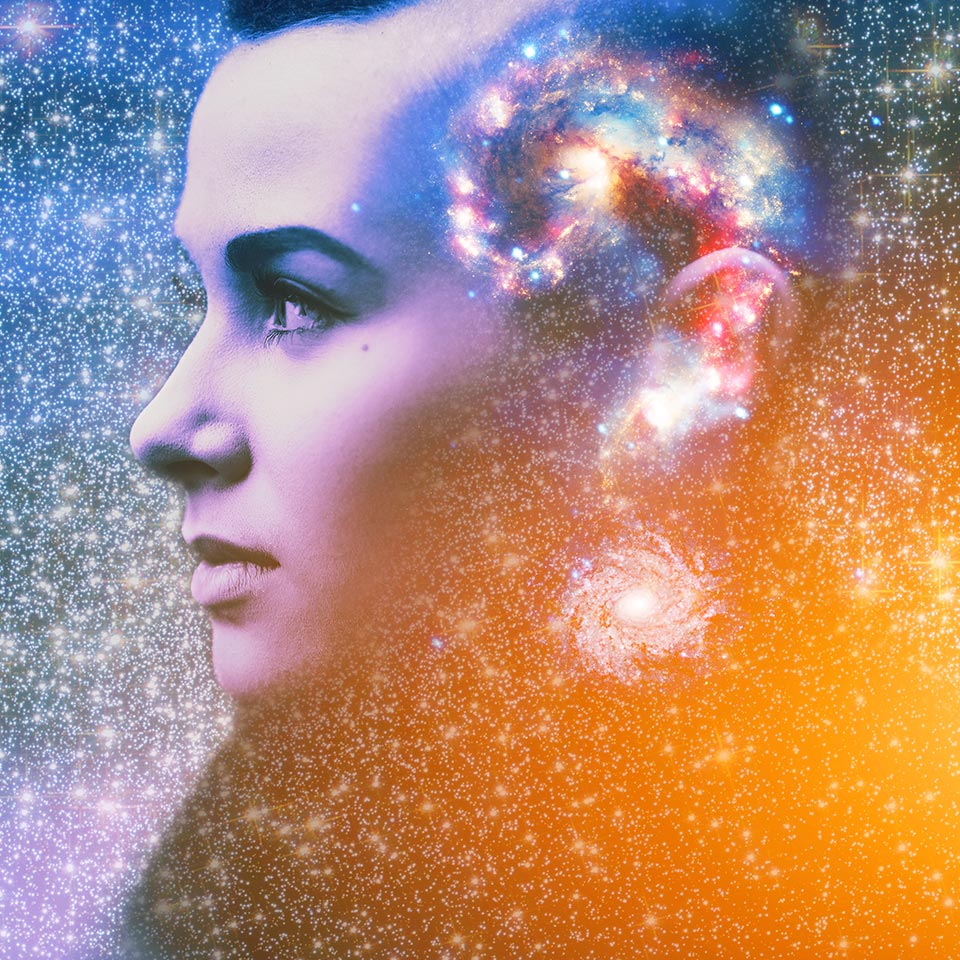 Double multiply exposure abstract portrait of young woman's face with a galaxy in the shape of a question mark inside her head
