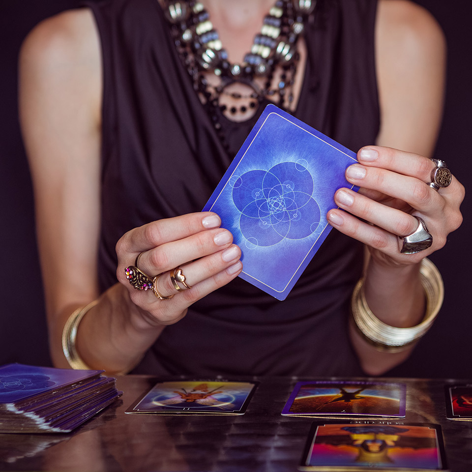 Fortune teller forecasting the future with cards