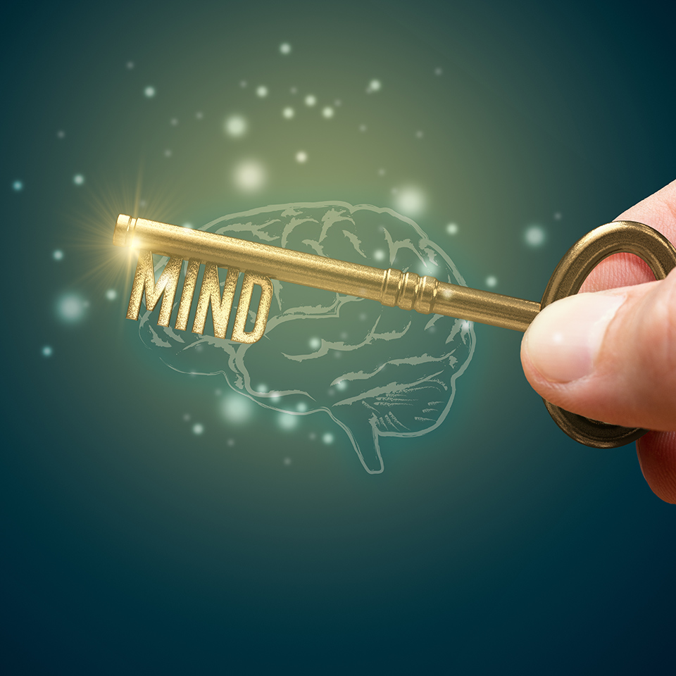 A key, shaped into the word mind above an illustration of a brain