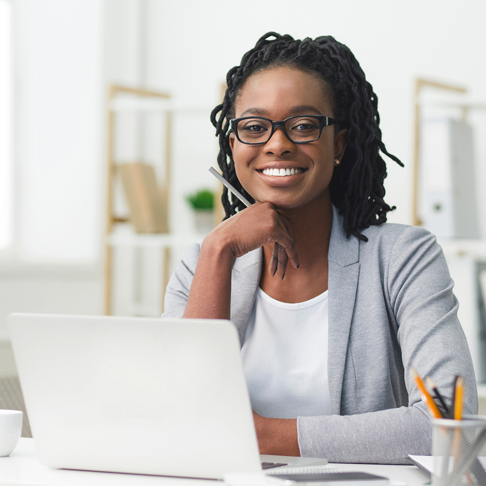 Administrative assistant sat at a desktop
