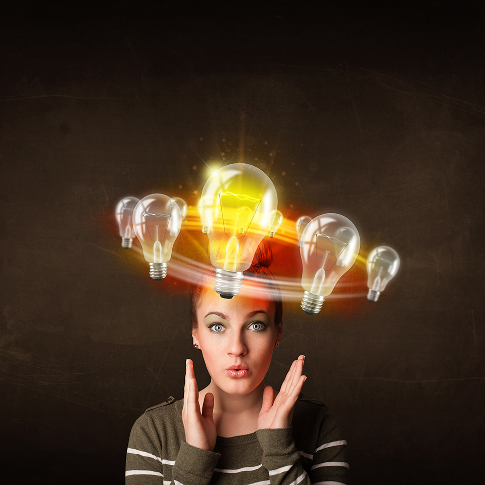 Woman with light bulbs circling around her head - one of them is brightly lit