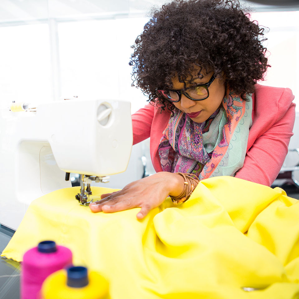 Fashion designer working with a sewing machine
